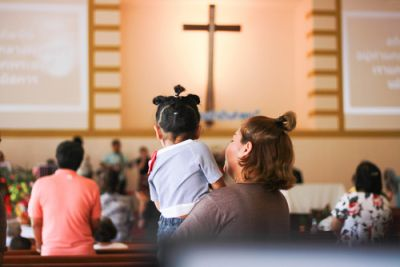 Children with parents attending church