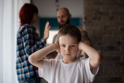 Child Listening to Parents Fighting