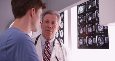 A doctor explaining the link between fundamentalism and brain damage