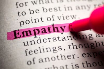 Someone highlighting the word Empathy in the dictionary
