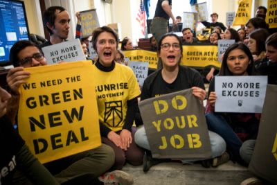 Supporters of climate action with Green New Deal signs