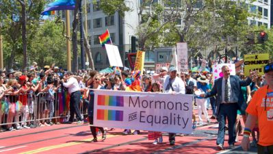 Mormon parade walkers marching for equality