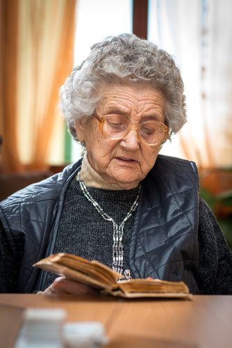 Older Woman Reading a Bible