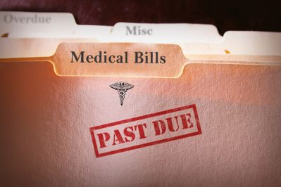 A file of medical bills stamped as past due