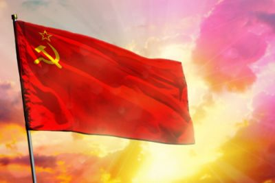 A Soviet flag flying surrounded by divine light